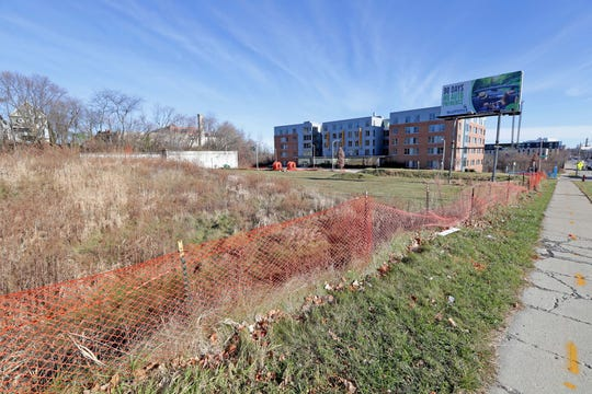 The mixed-use development with 91 apartments and a food entrepreneurship center is planned for a large vacant site just west of University of Wisconsin-Milwaukee's RiverView Residence Hall (right).