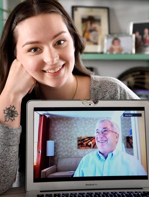 Preston O'Neal, a Donald Trump supporter, and  his daughter, Shelby O'Neal, a Biden supporter, talk via Zoom about their different views on politics in Nashville, Tenn. Tuesday, Nov. 17, 2020.