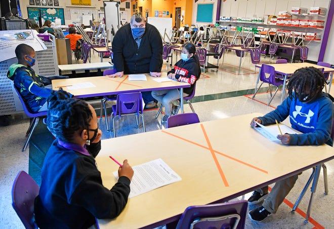 James Cross, Rocketship Nashville Northeast Elementary teacher, teaches reading to his students in Nashville, Tenn. Tuesday, Nov. 17, 2020.