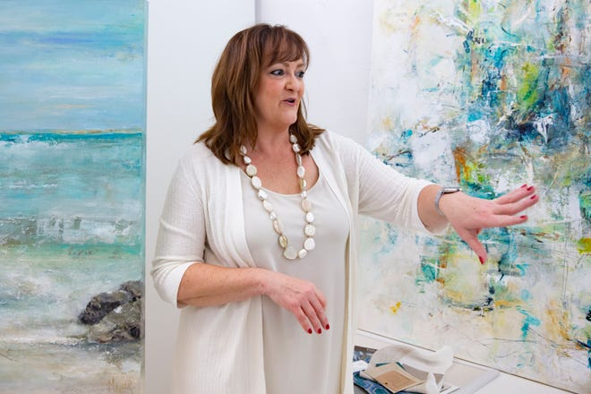 Carrie Coldiron talks about her ideas that compliment the art work by Sandee Mahler, Monday, Nov. 16, 2020, at Mahler's studio ARTEDGE in North Naples.