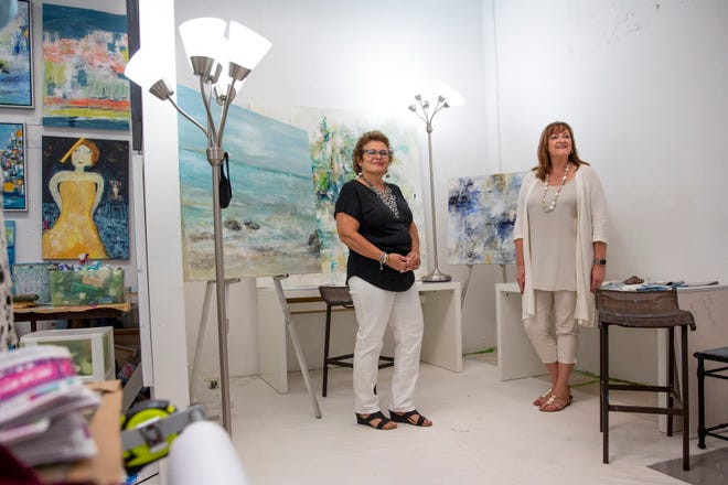 Sandee Mahler, left, artist and owner of ARTEDGE and Carrie Coldiron interior designer at Jeffrey Fisher Home talk participate in an interview at Mahler's studio on Monday, Nov. 16, 2020.