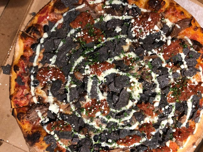 Twisted Sheep Pizza and Brew in Naples serves its pig and sombrero pizza ($18) topped with braised pork, salsa, cotija, crushed blue tortilla chips, black beans, jalapeno ranch aioli, cheddar and mozzarella.