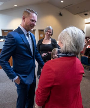 New Santa Rosa County Commissioner Colten Wright talks with a supporter after taking his oath of office on Tuesday, Nov. 17, 2020. Santa Rosa County welcomed two new faces to its board of county commissioner during the ceremony.