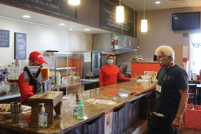 """The crew at Bistro 163, a local """"pay-it-forward"""" restaurant in Port Clinton, awaits more customers during the early lunch hours on Tuesday. They have been among many establishments in Ottawa County following the guidelines to stay open while mitigating potential spread of COVID-19."""