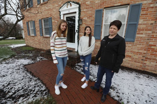 Kim Johnston and her daughters, Katie, 14, and Meghan, 16, wearing a white sweater, at their Fairport, NY home on November 17, 2020 plan on doing their Black Friday shopping from the safety of their own home.  Usually the are out of state for Thanksgiving and go on a shopping trip but with COVID being a concern, their shopping will take place online.