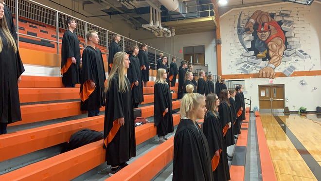 The Dell Rapids high school choir performs a virtual Veterans Day concert from the Dells gymnasium.