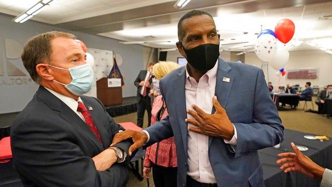 Utah Gov. Gary Herbert, left, speaks with Burgess Owens, Republican candidate in Utah's 4th Congressional District, during an Utah Republican election night party Tuesday, Nov. 3, 2020, in Sandy, Utah. (AP Photo/Rick Bowmer)