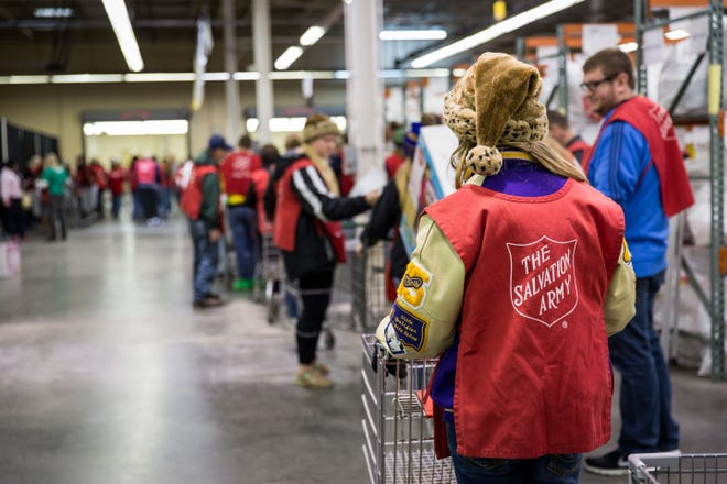 Salvation Army volunteers collect gift donations as part of the Angel Tree program. Angel trees will be at 12 locations in the Wichita Falls area.