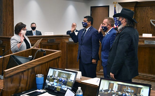 City Clerk Marie Balthrop swears in re-elected City Council members Mayor Stephen Santellana, District 3 Councilor Jeff Browning and District 5 Councilor Steve Jackson. District 4 Councilor Tim Brewer was absent.