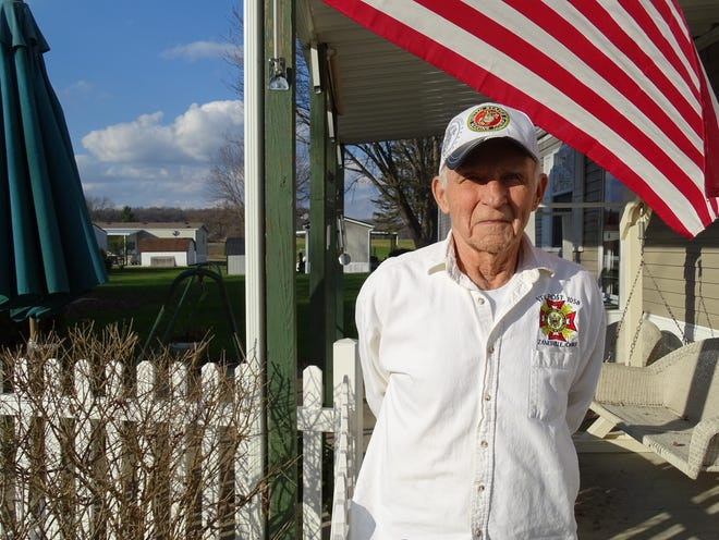 John Norman, 76, stands outside of his Frazeysburg home.
