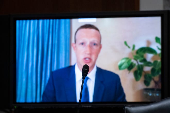 Facebook CEO Mark Zuckerberg testifies remotely during a Senate Judicial Committee hearing about Facebook and Twitter's actions in connection with Tuesday's highly competitive election.