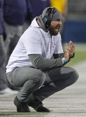 Kent State Golden Flashes head coach Sean Lewis works the sideline during the first half of an NCAA football game against the Akron Zips, Tuesday, Nov. 17, 2020, in Kent, Ohio. [Jeff Lange/Beacon Journal]