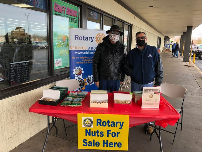 Rotarians Dave Kowalka (left) and Mitch Piskur are selling Rotary holiday nuts outside of Miller-Hawkings Market on Saturday, Nov. 14. Due to the COVID pandemic, the Rotary Club of Ashland has made some changes in its annual holiday nut sales fundraiser. In addition to contacting any Rotarian, orders can be placed by calling 419-281-1040 and the staff at Armstrong Accounting will arrange curbside pickup. Orders also can be placed online at ashlandrotary.net. This project funds the service club's scholarships to local high school graduates.