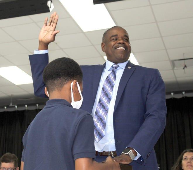 School board member Fonda Davis was helped by his grandson Bentley Davis
