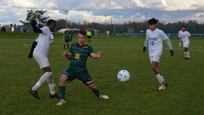 AP Schalick junior midfielder Mike Bergholz (10) battles Peter Boima (left) and Timur Rozikov of Maple Shade for possession during Tuesday's South West A, Group 1-A playoff game. Bergholz scored the winning goal in Schalick's 3-2 victory.