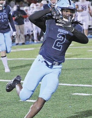 Nick Folks celebrates an interception for Bartlesville High School during home action in October.