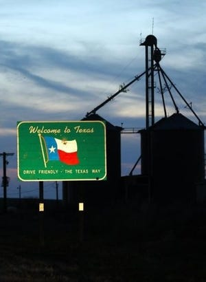 A sign welcomes drivers to Texas at the end of Oklahoma's State Highway 33 on the edge of western Oklahoma.