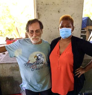 Camp resident Mr. Tony showed Tasha Walker around the Truman bridge site where people who are homeless can be found.