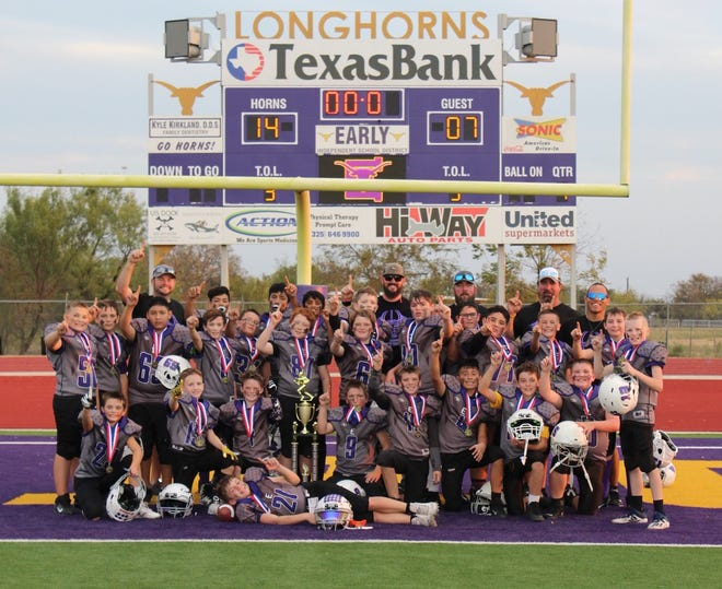 The Early Pee Wee football team, which played in the West Texas Rural Youth Football League, is pictured after winning the league's Super Bowl Saturday at Longhorn Stadium. The Pee Wee team, consisting of fifth- and sixth-graders, defeated Clyde 14-7.