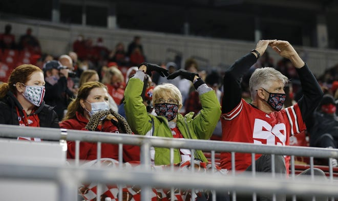 "Family members of Ohio State football players cheer for the playing of ""Hang On Sloopy"" during the Buckeyes' game against Rutgers on Nov. 7."