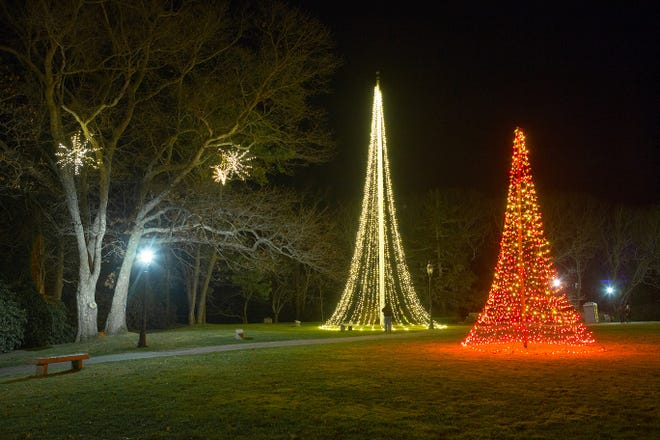 "Trees made of lights are part of the decorations at Heritage Museums & Gardens annual ""Gardens Aglow"" event, which opens Friday with COVID-19 protocols in place."
