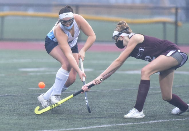 Paige Hawkins, left, earned Most Valuable Player honors in the Cape and Islands Atlantic Division this fall, leading Sandwich with 16 goals and seven assists. [Steve Heaslip/Cape Cod Times file]