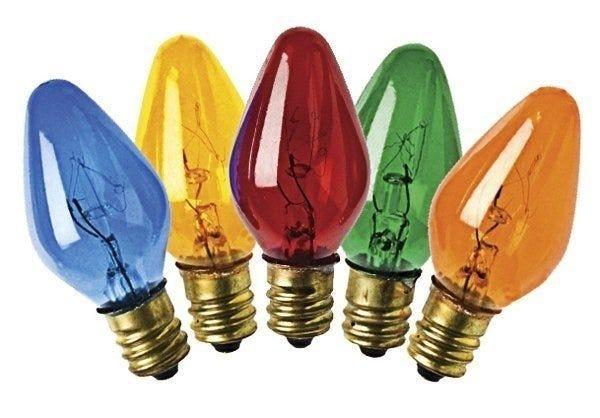 Four colored christmas lightbulbs on white