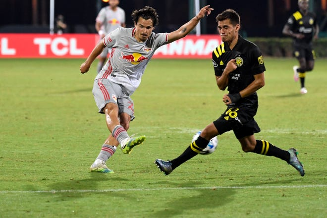The Crew's Hector Jimenez (16) blocks a shot by Red Bulls midfielder Florian Valot in the teams' only meeting this season, a 2-0 Columbus victory on July 16 in Orlando, Florida.