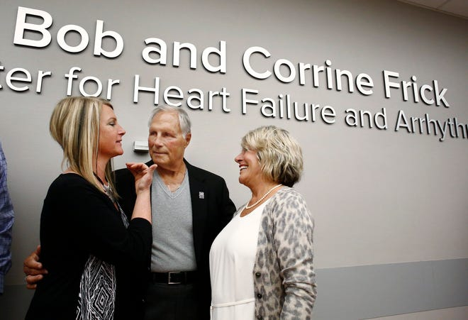 The Bob and Corrine Frick Center for Heart Failure and Arrhythmia at Ohio State University's Richard M. Ross Heart Hospital was created as part of an $18 million donation from the Fricks, who are co-founders of the Rooster's restaurant chain.  In this file photo, Amy Wilson, left, and her parents, Bob and Corrine, are pictured at the center's dedication on April 4, 2018.