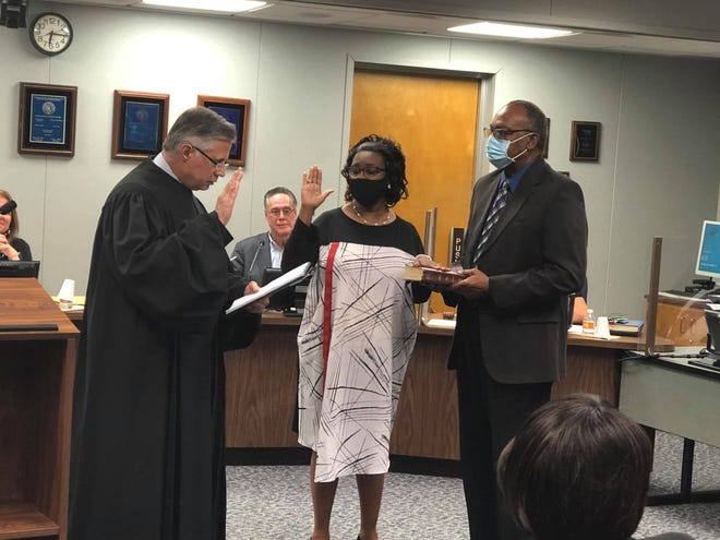 Retired educator Mollie Cunningham is sworn into her position as a School Board member for District 4 on Tuesday, Nov. 17.