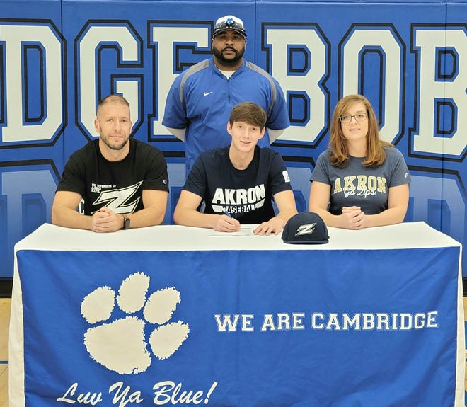 Cambridge senior Sean Perkins a letter of intent for the University of Akron at Cambridge High School recently. Pictured here front, from left are: Aaron Perkins, Sean and Brandy Perkins; back, coach Jamaal Lowery.