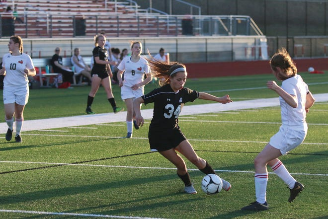 ADM's Abby Gonzalez knifing through the Boone defense during a home outing in 2018.