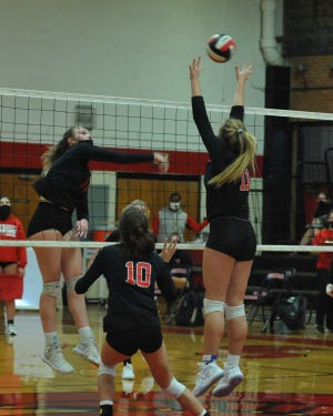 Central Davidson's Madison Tate hits the ball against East Surry in a Tuesday match. [Mike Duprez/The Dispatch]