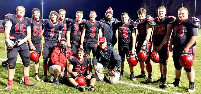 Honesdale's varsity football team has put the finishing touches on a solid first season under rookie head coach Paul Russick. The Hornets posted two late wins over Mid Valley and West Scranton to close out the pandemic-shortened season at 2-5. Pictured are (kneeling from left): Coach Gordy West, Jordan DeGroat, Coach Jeff Kent. Standing are: Sam Deron, Tim Dailey, Peter West, Bradley Bennett, Kyle Hanson, Connor Schmitt, Coach Russick, Jakob Burlein, Geoffrey Johnson, Kane Rogers, Tanner Rowles.