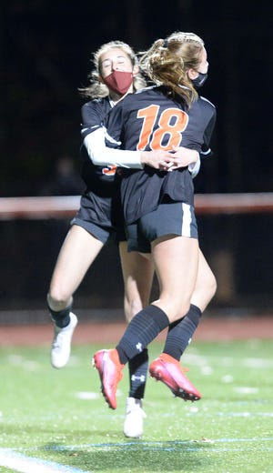 Oliver Ames' Jenna Gilman, left, and Carly Gibson celebrate Gibson's goal during their game versus King Philip on Tuesday, Nov. 17, 2020.