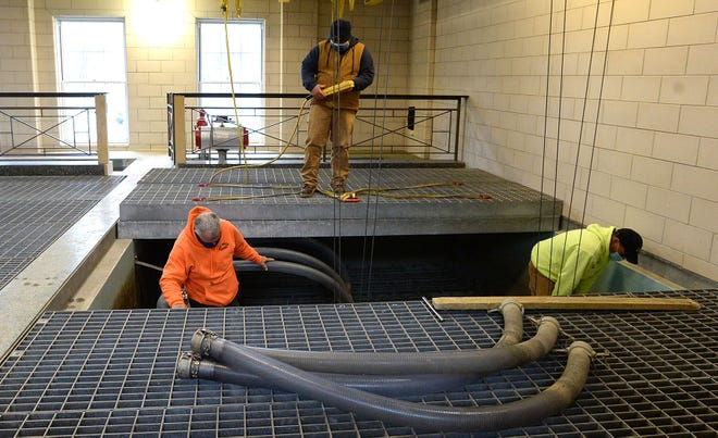 Bob Nicastro, left, Shane Irwin, center, and Mark Bowen, right, maintenance technicians from Erie Water Works, replace the membranes on a filtration tank Wednesday at the Wasielewski Water Treatment Plant in Millcreek Township.