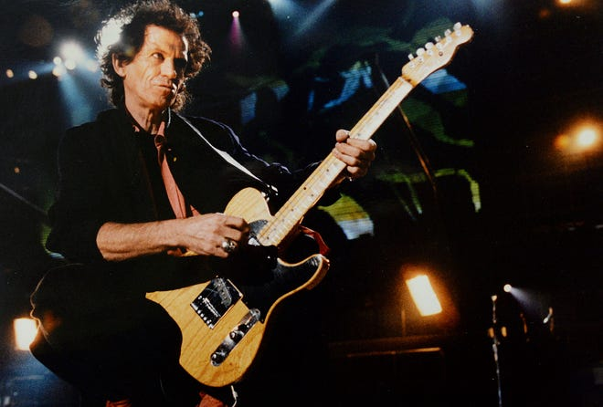 Keith Richards and the Rolling Stones perform Sept. 29, 1994, at Three Rivers Stadium in Pittsburgh during the Voodoo Lounge tour. Richards on Nov. 13 released a limited edition box set of his 1988 concert at the Hollywood Palladium taken during his first solo tour. He has been promoting the release in a series of interviews.