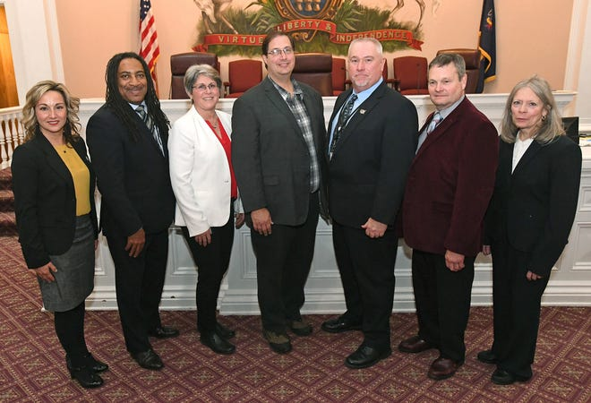 The seven Erie County Council members are shown Jan. 3. From left, are: Kim Clear, D-1st Dist; Andre Horton, D-2nd Dist; Mary Rennie, D-3rd Dist.; Carl Anderson, D-4th Dist; Brian Shank, R-5th Dist.; Scott Rastetter, R-6th Dist; and Ellen Schauerman, R-7th Dist.