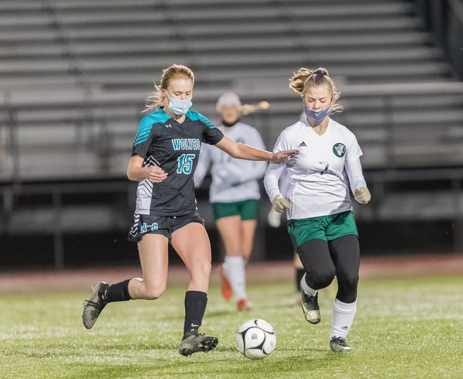 Arkport/Canaseraga's Maureen Stuckey (15) pushes the pace as Genesee Valley's Adison Grusendorf defends Tuesday night in Houghton.
