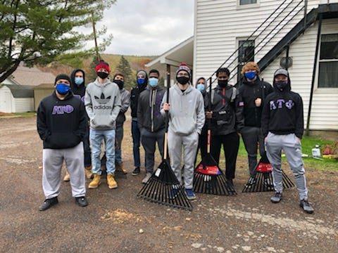 Brothers of Lambda Tau Phi volunteered on Halloween to assist the Almond Community church with raking leaves, power washing, and other tasks. From left to right are Kamren Bu'Fearon, Russell Zagrobelny, Augustus Batcho, Derek Rice-Porter, Isaiah Martin, Markel Edwards, Carson Gage, Frank Vinueza, Zacchaeus Robinson, Jacob Gehr, and Drew Serwinowski.