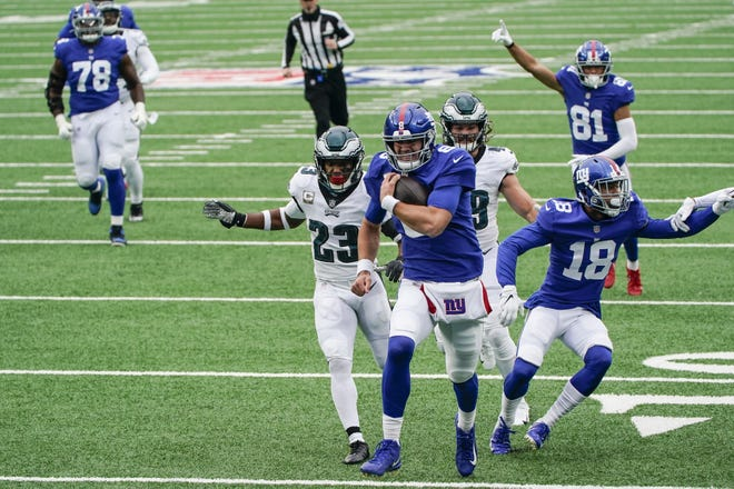 New York Giants quarterback Daniel Jones runs away from the Philadelphia Eagles' Rodney McLeod (23) for a touchdown during the first half of Sunday's game in East Rutherford, New Jersey.