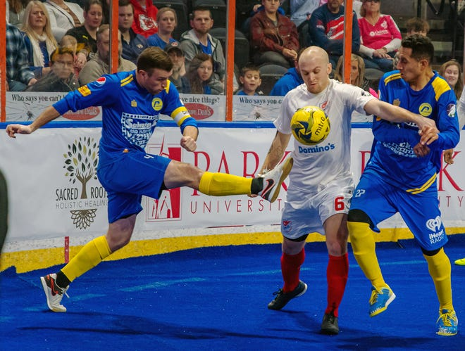 Kansas City Comets forward Adam James (6), center, tries to work the ball through a pair of Rochester defenders in a game last season. James, a Kearney, Mo., native, has signed for his fourth season with the Major Arena Soccer League club.