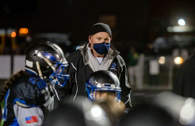 Grain Valley defensive coordinator joins the post-game talk after the Eagles defeated Raytown 42-7 Friday. The longtime area coach has announced he will retire as a coach and teacher following this season.