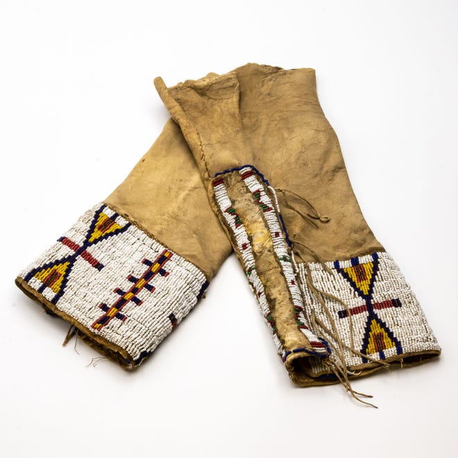 Leggings made from brain-tanned mule deer or elk hide, cotton thread, animal sinew and glass beads, an Out of the Attic item, are shown at the Des Moines County Heritage Center, 501. N. Fourth St., in Burlington.