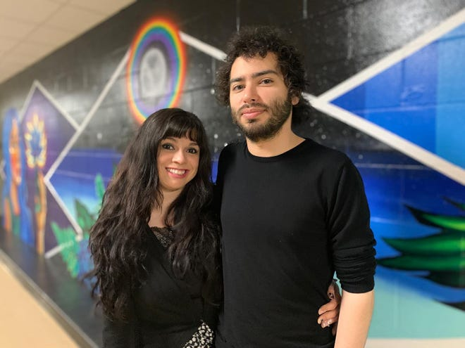 Bianca Mireles, left, and Isaac Mortazavi, creator of multiple murals in Rochester, including this one inside the Rochester Community Center, is among the local artists excited Rochester plans to install roughly 10 new pieces of public art as part of a grant-funded project. [Courtesy of the Rochester Museum of Fine Arts]