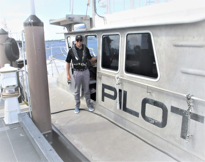 Capt. Chris Mons on the deck of his pilot boat. The Atlantic Beach resident became a bar pilot in 2008, joining a tradition that dates back to the mid-19th century.