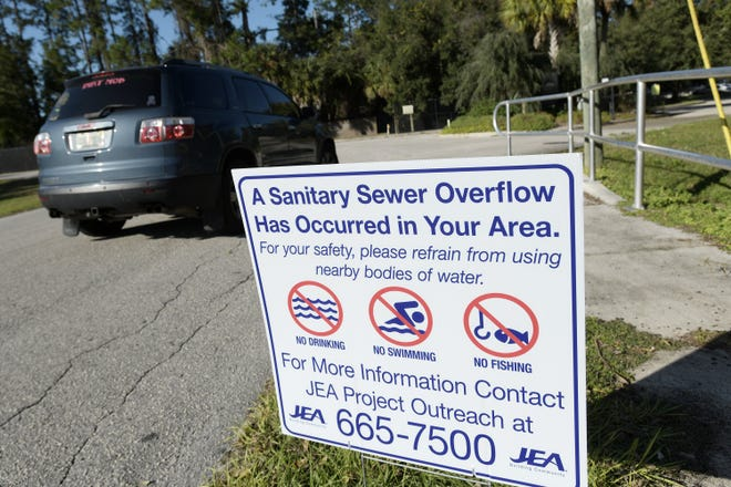 A sign warned of a sanitary sewer overflow in the area along Milcoe Road by the entrance to the Jacksonville Arboretum near JEA's Arlington East Wastewater Treatment Facility Wednesday, More than 400,000 gallons of sewage is estimated to have overflowed south of that area near Jones Creek, which passes through the arboretum.