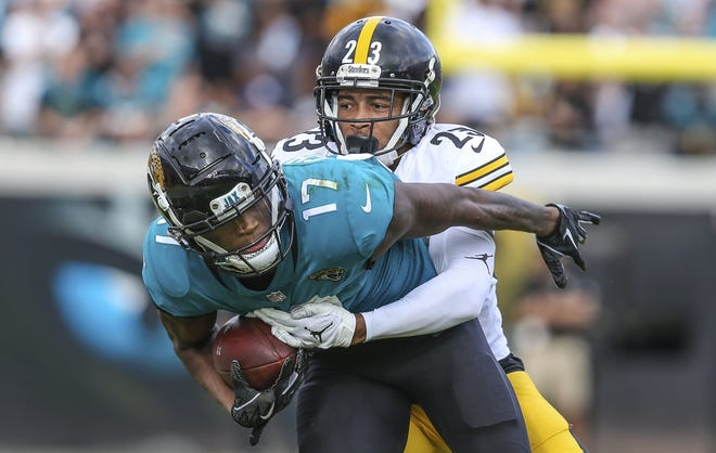 Jaguars wide receiver D.J. Chark is tackled by Steelers cornerback Joe Haden during a 2018 game, the teams' most recent meeting.