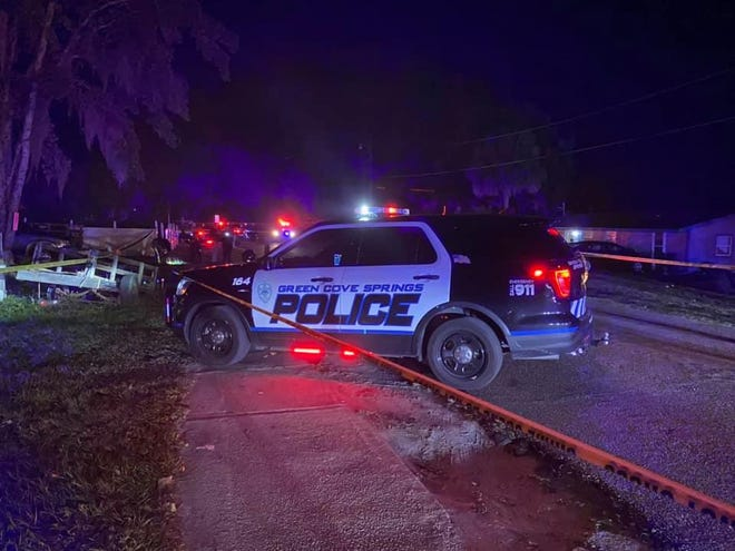 Green Cove Springs police work a triple shooting on Center Street.