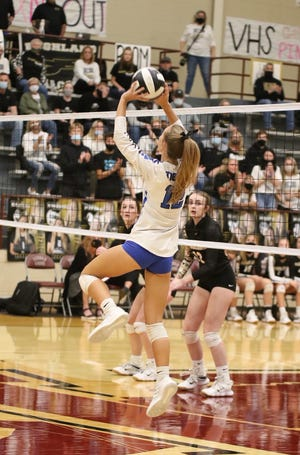 Gunter's Jacee Childers sets the ball during the Lady Tigers' state semifinal match against Bushland in Vernon.